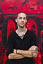 Portrait of man in front of a graffiti wall - MGIF00002