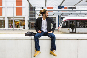 Young businessman with dreadlocks waiting at station - MGIF00020