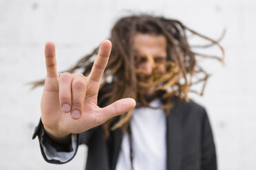 Man showing Rock And Roll Sign, close-up - MGIF00032