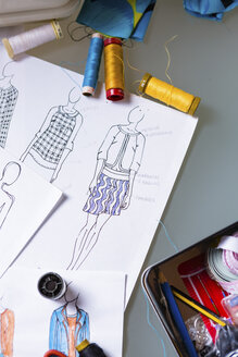 Fashion designer's sketches on a working table - MGIF00056