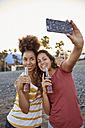 Two best friends taking selfie on the beach - PACF00044