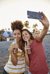 Two best friends taking selfie on the beach - PACF00044