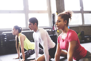 Three young people exercising in gym - HAPF01792