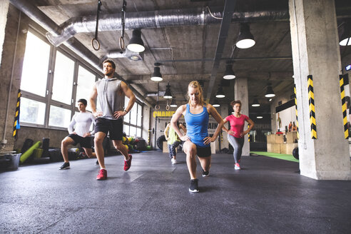Group of young people exercising in gym - HAPF01798
