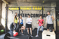 Portrait of confident young people posing in gym - HAPF01810