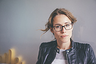 Portrait of young woman with glasses and leather jacket - KNSF01673
