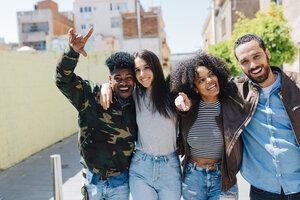 Happy stylish friends walking on urban street - GIOF02819