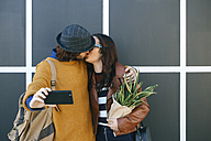 Kissing young couple taking selfie with smartphone - RTBF00945