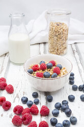 Bowl of granola with raspberries and blueberries - LVF06197