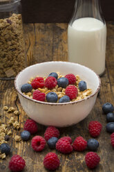 Bowl of granola with raspberries and blueberries - LVF06200