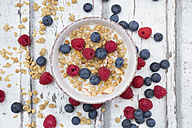 Bowl of granola with raspberries and blueberries - LVF06203