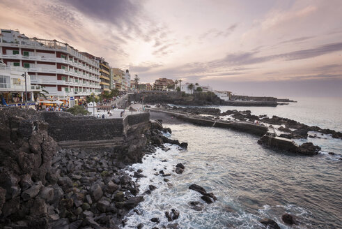 Spain, Canary Islands, Tenerife, Puerto de la Cruz at sunset - DHCF00084