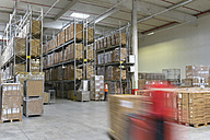 Man in factory hall and moving forklift - LYF00740