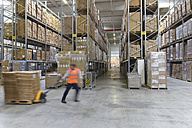 Man in factory hall using pallet jack - LYF00749
