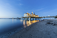 Germany, Ruegen, Sellin, view to lighted sea bridge at sunset - ASCF00753