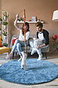 Young couple playing with kittens in the living room - RTBF00970