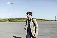 Young man with backpack outdoors - GIOF02869