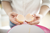 Girl's hands separating eggs, close-up - MOEF00027