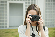 Young woman looking through camera - CHAF01900