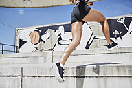 Fit woman running outdoors - SUF00194