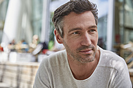 Portrait of man at an outdoor cafe - SUF00215
