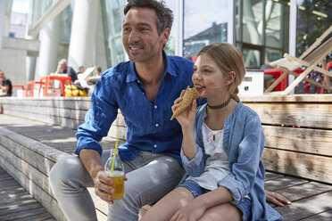 Father with drink and daughter with ice cream cone at an outdoor cafe - SUF00218