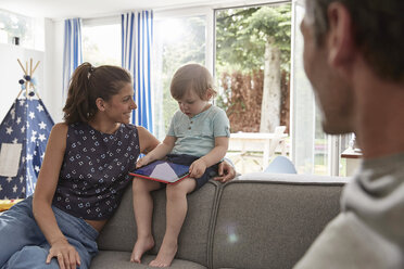 Mother watching little son using tablet at home - SUF00227