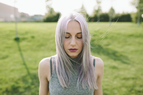 Young woman with pink grey hair on a meadow - GIOF02899