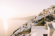 Greece, Santorini, Fira, white village view over the sea at sunset - GEMF01735