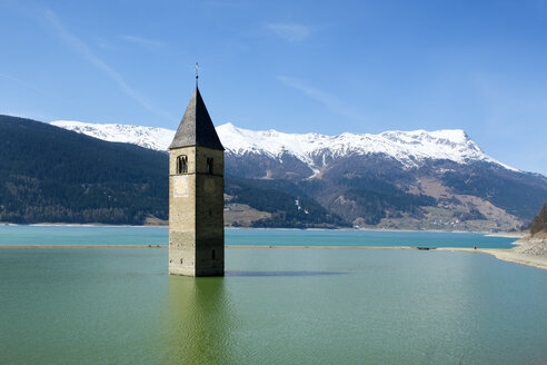 Italy, Alto Adige, Church spire of Alt-Graun in Lake Reschen - LBF01613