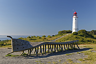 Germany, Mecklenburg-Western Pomerania, Hiddensee, Dornbusch lighthouse on the Schluckswiek, with old twisted wood bench in foreground - GFF01007