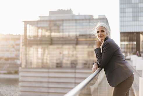 Portrait of confident businesswoman standing on bridge - KNSF01786