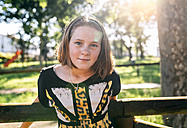 Portrait of freckled girl outdoors - MGOF03447
