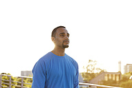 Portrait of confident athlete in the city - FKF02434