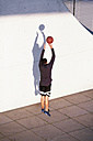 Young man playing basketball in the city - FKF02440