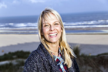 Portrait of happy woman at the sea - FMKF04207