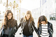 Three friends wearing black leather jackets - GIOF02949