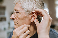 Senior man with hearing aid - ZEDF00748