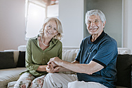 Portrait of smiling senior couple at home - ZEDF00772