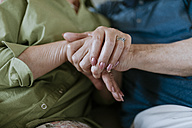 Close-up of senior couple holding hands - ZEDF00775