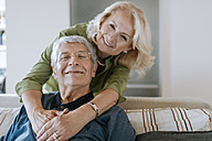 Portrait of affectionate senior couple at home - ZEDF00793