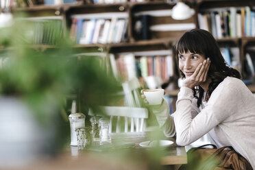 Woman in cafe drinking coffee, daydreaming - KNSF01859