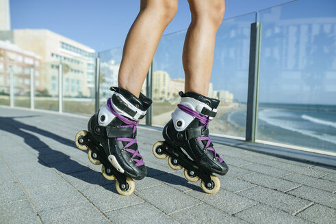 Close-up of woman's legs with inline skates - KIJF01659