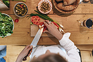 Woman chopping bell pepper in the kitchen, top view - GUSF00089
