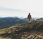 Austria, Salzkammergut, Hiker with backpack hiking in the Alps - UUF10982