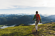 Austria, Salzkammergut, Hiker with backpack hiking in the Alps - UUF10985