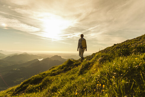 Austria, Salzkammergut, Hiker walking alone in the mountains - UUF10994