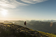 Austria, Salzkammergut, Hiker walking alone in the mountains - UUF11018