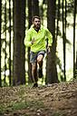 Man running in forest - MAEF12377