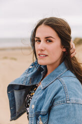 Portrait of young woman on the beach - NMSF00123